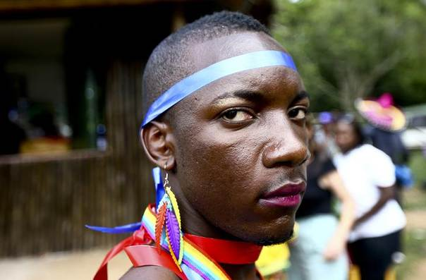 A man is pictured as he prepares for a parade to celebrate the annulment of an anti-homosexuality law by Uganda's constitutional court in Entebbe August 9, 2014. REUTERS/Edward Echwalu