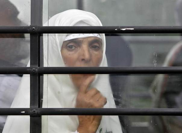 A Kashmiri Haj pilgrim looks from a bus window, before her departure for Mecca, in Srinagar August 27, 2014. REUTERS/Danish Ismail