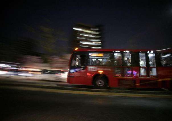 A Metrobus rides in Mexico City, Dec. 14, 2011. Mexico City's sleek public bus system has attracted significant international investment in carbon credits, part of the capital's ongoing effort to reduce pollution. REUTERS/Bernardo Montoya