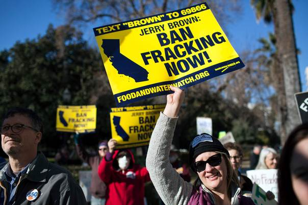 Kimberly Ramsey (R) protests fracking outside the State Capitol after Governor Jerry Brown delivered his State of the State address at the Capitol in Sacramento, California, on January 22, 2014. REUTERS/Max Whittaker