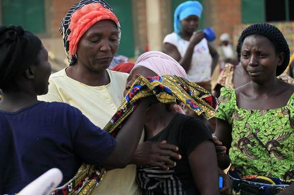 Women console Cicilia Audu after gunmen killed over 42 people in her house at Angwan Gata, Kaura Local Government Kaduna State March 20, 2014. REUTERS/Afolabi Sotunde