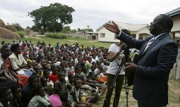 Zimbabwean Prime Minister Morgan Tsvangirai addresses orphans and AIDS patients at Mathew Rusike Children's Home in the suburb of Epworth, in the capital Harare. Picture December 17, 2009.  REUTERS/Philimon Bulawayo