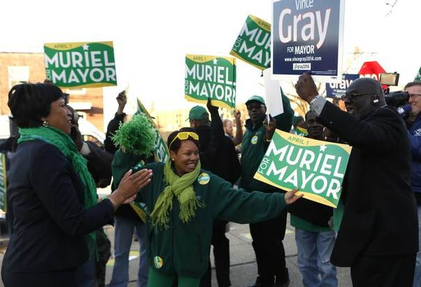 Council member Muriel Bowser (L) talks to a supporter of Washington DC Mayor Vince Gray after voting in the District of Columbia Democratic mayoral primary election at Lasalle Elementary School in Washington. Picture April 1, 2014, REUTERS/Yuri Gripas
