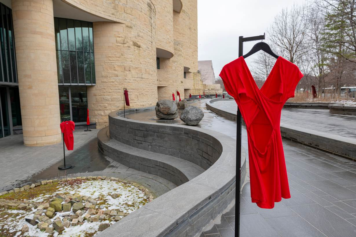 Dresses hang on the grounds of the National Museum of the American Indian in Washington, D.C. on March 1, 2019, as part of the REDress Project, an art installation by artist Jaime Black. Handout photo by National Museum of the American Indian staff.
