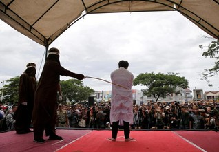 Indonesia's Aceh resumes public caning despite pledge to curb access