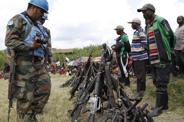 United Nations peacekeepers record details of weapons recovered from the Democratic Forces for the Liberation of Rwanda (FDLR) militants after their surrender in Kateku, Democratic Republic of Congo, May 30, 2014. REUTERS/Kenny Katombe