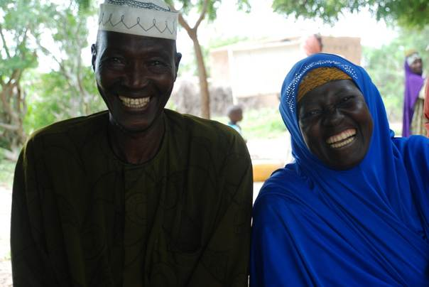 Mamou, seen with her husband Seyni, used micro-finance loans to tide over hard times. Credit: Plan