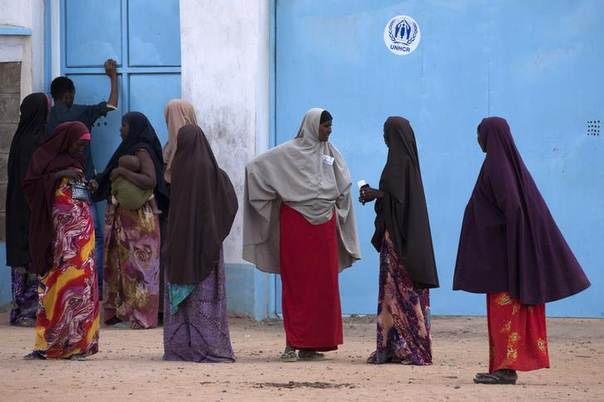 Somali refugees stand outside a UNHCR field office in Dagahale, one of the several refugee settlements in Dadaab, Garissa County, northeastern Kenya, October 7, 2013. REUTERS/Siegfried Modola