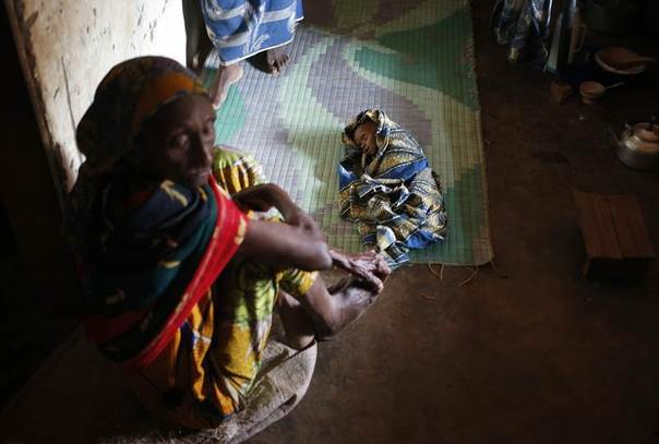 A sick internally displaced child lies in a house in the town of Boda, Central African Republic, April 15, 2014. REUTERS/Goran Tomasevic