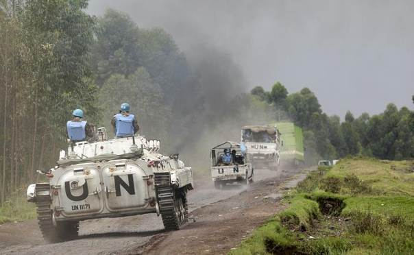 U.N. peacekeepers patrol past the deserted Kibati village near Goma in the eastern Democratic Republic of Congo, August 7, 2013. REUTERS/Thomas Mukoya
