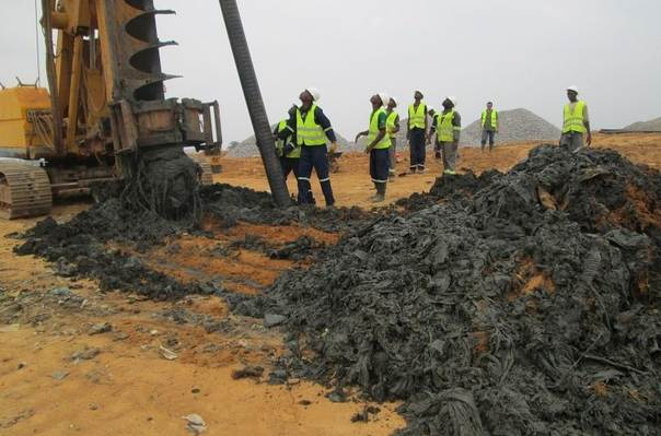 Workers at the Nkolfoulou-Yaounde landfill site in Cameroon. TRF/ Elias Ntungwe Ngalame