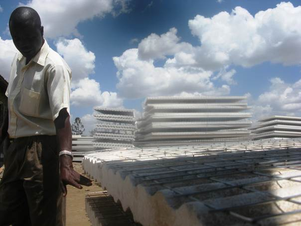 Adriano Chimoyi, managing director of a housing construction company, describes how the expanded polystyrene (EPS) panels are used to build homes at a construction site in Ruai, a a town on the outskirts of Nairobi. THOMSON REUTERS FOUNDATION/Kagondu Njagi