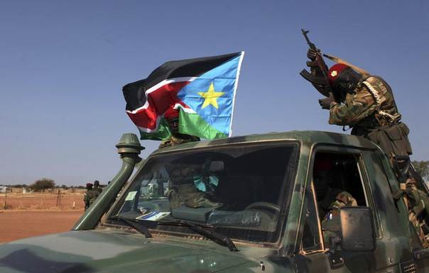 SPLA soldiers are pictured on a pick-up truck in Bentiu, in Unitiy state, South Sudan, January 12, 2014. REUTERS/Andreea Campeanu
