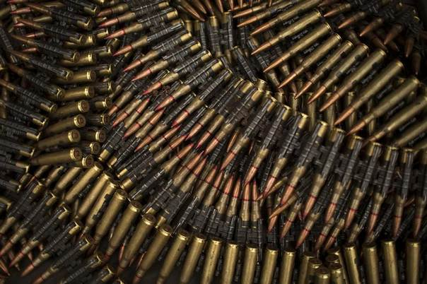 Large calibre bullets are pictured on the ground in Camp de Roux, a main base recently abandoned by former Seleka fighters near the centre of the capital Bangui January 28, 2014. REUTERS/Siegfried Modola