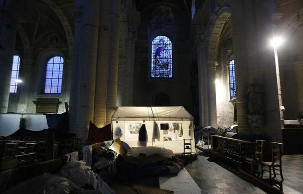 A tent is illuminated as Afghan asylum seekers camp inside the Church of Saint John the Baptist at the Beguinage in central Brussels, February 6, 2014. REUTERS/Francois Lenoir