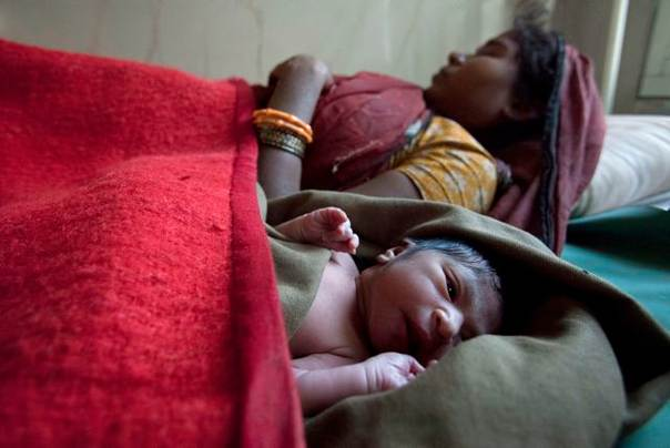 Anguri, 26, rests with her newborn baby at a community health centre in the remote village of Chharchh, in the central Indian state of Madhya Pradesh, on Feb. 24, 2012. REUTERS/Vivek Prakash