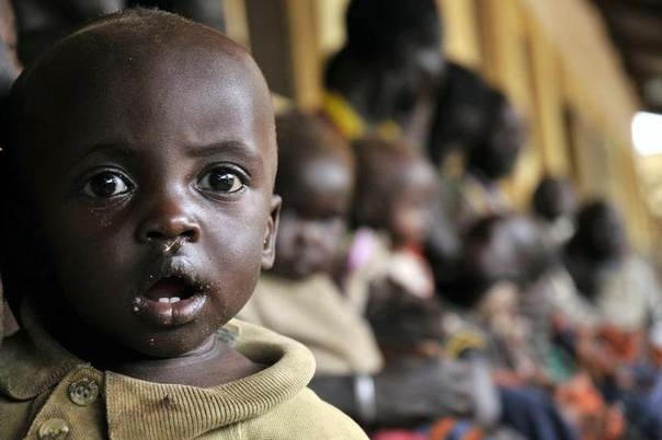 A child waits in his mother's arms for malnutrition treatment at Matany hospital in Uganda's Karamoja region, 700 km (420 miles) northeast of the capital Kampala, May 21, 2008.  REUTERS/James Akena