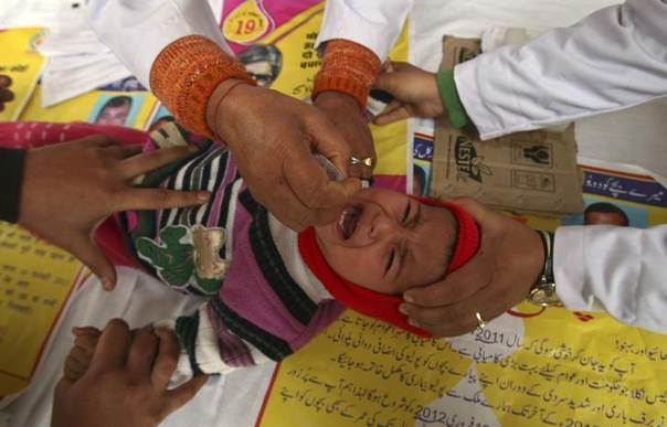 A child receives polio drops during an Indian polio eradication programme in Jammu. Picture February 19, 2012. REUTERS/Mukesh Gupta