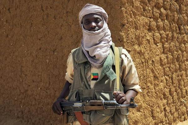 A fighter with the Tuareg separatist group MNLA (National Movement for the Liberation of Azawad) stands guard in Kidal, northern Mali, June 23, 2013. REUTERS/Adama Diarra