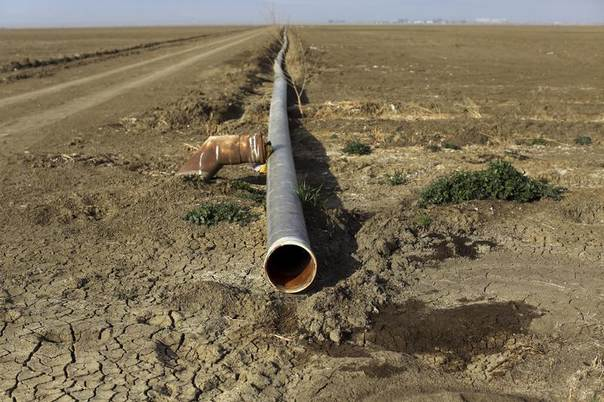 An irrigation pipe is seen on a farm near Cantua Creek, California, Feb. 14, 2014. REUTERS/Robert Galbraith