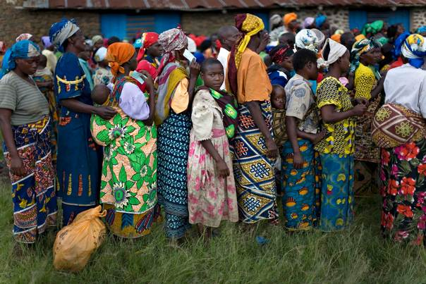 In a 2008 file photo, people displaced by fighting wait for aid to be distributed at the village of Ntamugenga in eastern Congo. REUTERS/Finbarr O'Reilly
