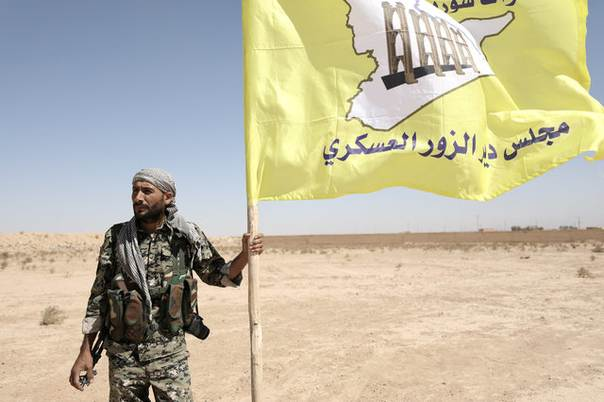 983018c7 FILE PHOTO: A fighter from Deir al-Zor military council which fights ...