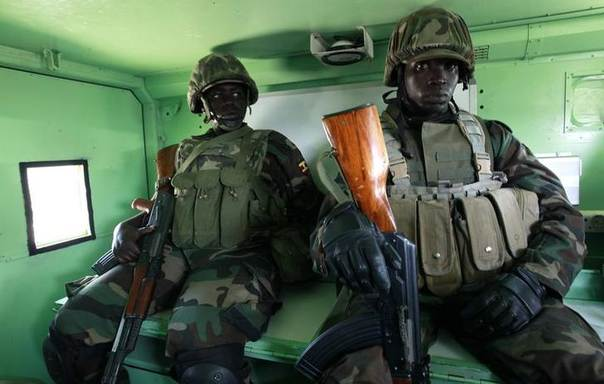 Ugandan peacekeepers from the African Union Mission in Somalia (AMISOM) ride in an Armoured Personnel Carrier (APC) as they patrol the streets of Somalia's capital Mogadishu, August 31, 2011. REUTERS/Thomas Mukoya
