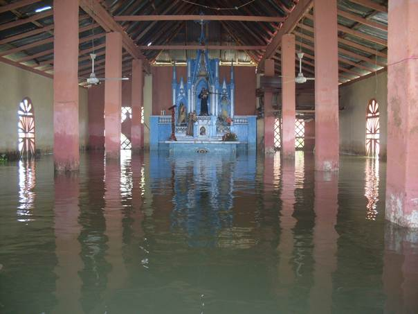 A flooded church sits underwater in Bocas de San Antonio, Sucre, a village in Colombia's Momposina depression, on May 11, 2011. THOMSON REUTERS FOUNDATION/Juan Camilo Castro