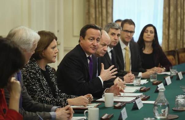 British Prime Minister David Cameron (C) sits with Secretary of State for Culture Media and Sport Maria Miller (3rd L) at an internet safety summit aimed at cracking down on  internet paedophiies. Picture No.10 Downing Street, London, November 18, 2013. REUTERS/Gareth Fuller/pool
