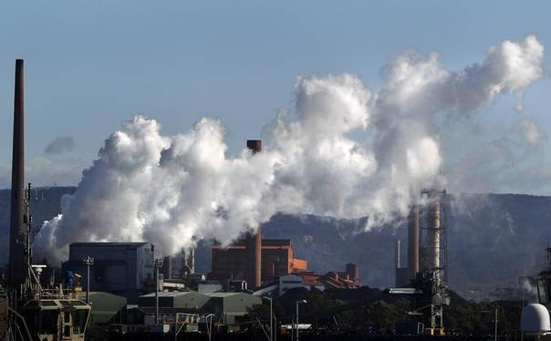 Vapour pours from a steel mill chimney in the industrial town of Port Kembla, about 80 km (50 miles) south of Sydney, July 7, 2011. REUTERS/Tim Wimborne