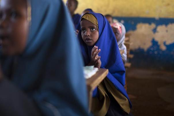 Children sing a song of welcome at a primary school in Dagahale, one of several refugee settlements in Dadaab, Garissa County, northeastern Kenya, October 9, 2013. REUTERS/Siegfried Modola