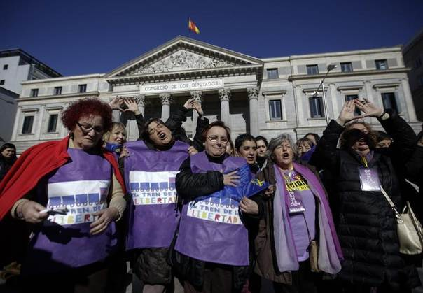 Women pose in front of the Spanish parliament after taking a petition to parliament against a government plan to limit abortions, in Madrid February 1, 2014. REUTERS/Andrea Comas