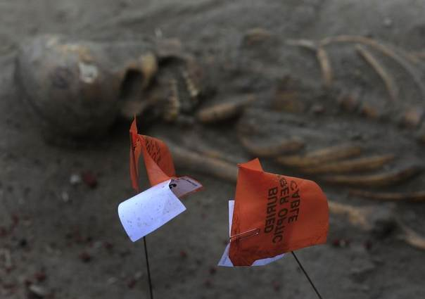 A marked human skeleton is seen at a construction site in the former war zone in Mannar, about 327 km (203 miles) from the capital Colombo, Sri Lanka, January 16, 2014. REUTERS/Dinuka Liyanawatte