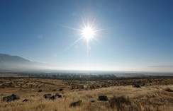 The sun shines above thick smog trapped in Utah Valley in Alpine, Utah