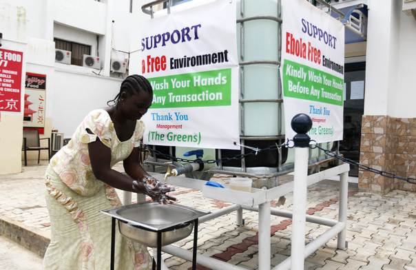 A woman washes her hands at a tap provided by the Green Pharmacy, Area 8, Abuja, on Sept. 1, 2014. Nigeria, where 18 cases of Ebola have been reported so far, has launched a national hand-washing campaign in a direct response to the outbreak. REUTERS/Afolabi Sotunde