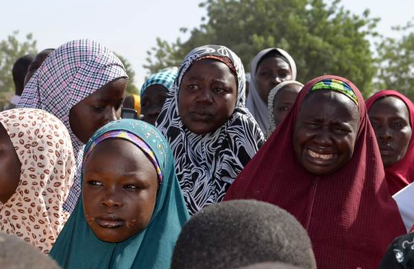 Mothers of kidnapped school girls react during a meeting with the Borno State governor in Chibok, Maiduguri, Borno state, on April 22, 2014. Parents of girls abducted by Islamist militants were searching for their daughters in a remote forest, they told the state governor on Monday, adding that 234 were still missing, a much higher figure than authorities said had been kidnapped. REUTERS/Stringer
