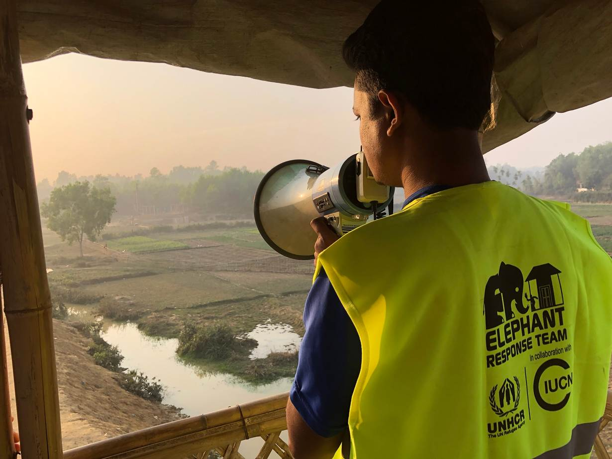 Nur Islam, one of about 570 Rohingya men who have joined the Elephant Response Team at the world's largest refugee camp south of Cox's Bazar in southeast Bangladesh keeps watch for elephants from a bamboo tower, Camp 4, Bangladesh, Jan 29, 2019. Photo credit: Thomson Reuters Foundation/Belinda Goldsmith