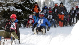 Competitors participate at the African Wintersports Cup, an integration project luge race, in Kleinarl, Austria