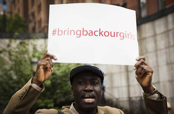 A demonstrator holds a sign above his head while chanting for the release of the Nigerian schoolgirls in Chibok who were kidnapped by Islamist militant group Boko Haram, outside of the United Nations headquarters in New York, May 22, 2014. REUTERS/Lucas Jackson