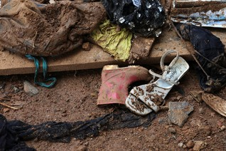 Shoes left after a flash flood during the mudslide at Pentagon, in Freetown