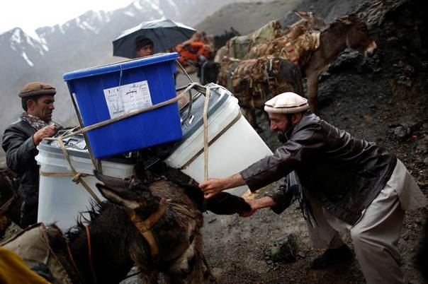 An Afghan man loads ballot boxes and other election material on a donkey to be transported to polling stations which are not accessible by road in Shutul, Panjshir province, April 4, 2014. REUTERS/Ahmad Masood