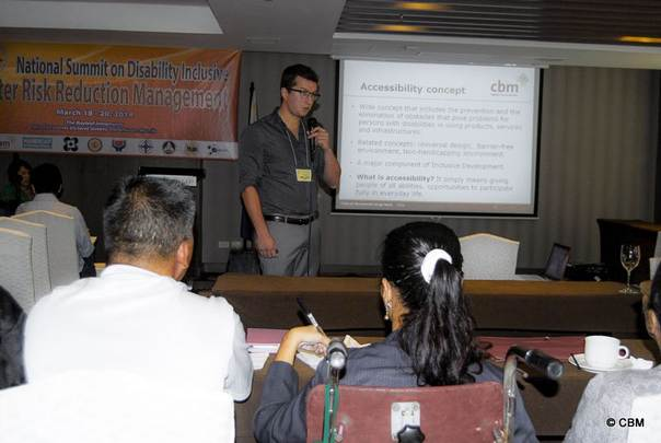 Benjamin Dard (CBM Technical Advisor for Accessibility) presenting on accessibility during Philippines DRR summit, March 2014. Copyright CBM