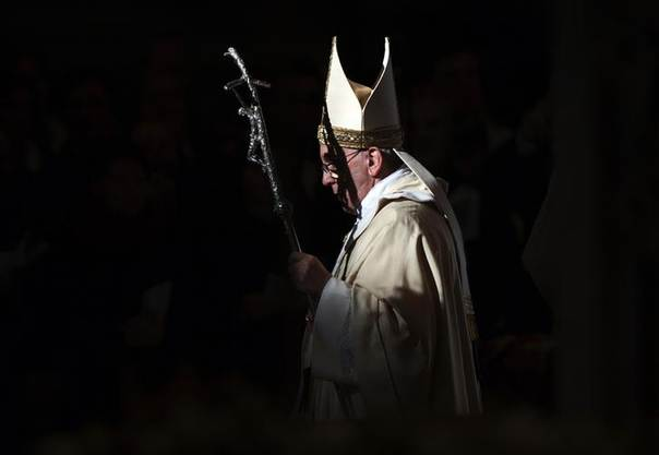 Pope Francis walks with his pastoral staff as he leads the Epiphany mass in Saint Peter's Basilica at the Vatican January 6, 2014. REUTERS/Max Rossi