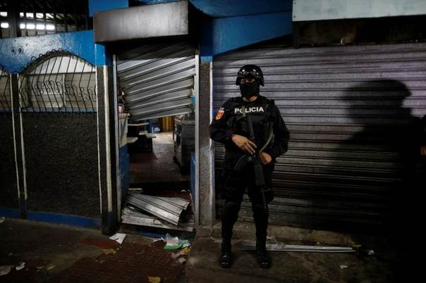 A Policeman Secure Seized MS 13 Gang Related Store During The Operation Cuscatlan In Ilopango