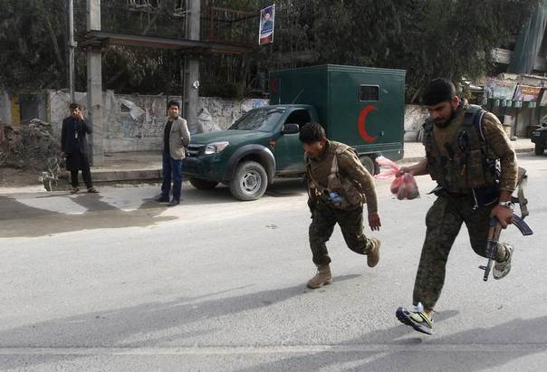 Afghan security forces run after a suicide car bomb attack in Jalalabad province, Afghanistan,March 20, 2014. REUTERS/Parwiz