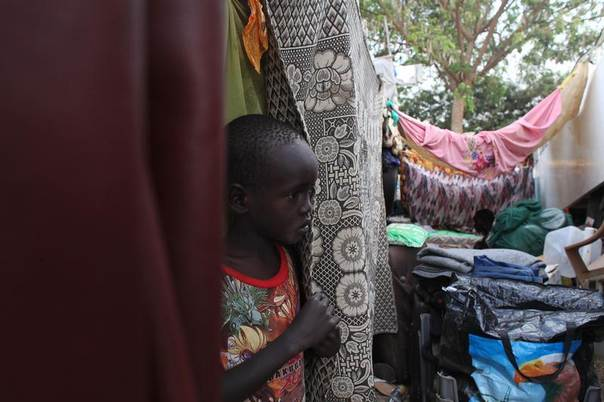 A displaced child is seen at Tomping camp, where thousands of displaced people who fled their homes are being sheltered by the United Nations, in Juba January 10, 2014. REUTERS/Andreea Campeanu