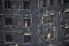 A member of the emergency services works inside the Grenfell apartment tower block in North Kensington, London, Britain