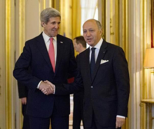 U.S. Secretary of State John Kerry (L) meets with France's Foreign Minister Laurent Fabius at the Quai d' Orsay in Paris March 27, 2013. REUTERS/Jason Reed