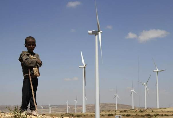 A boy stands in front of wind turbines at the Ashegoda Wind Farm, near a village in Mekelle, Tigray, 780 km (485 miles) north of Addis Ababa, Ethiopia, October 25, 2013. REUTERS/Kumerra Gemechu