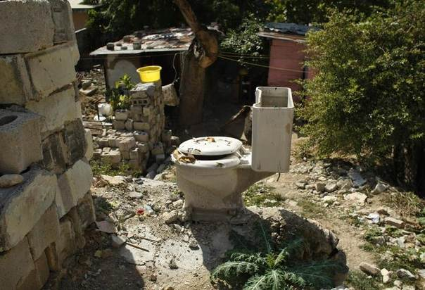 In this 2011 file photo, a toilet is seen in a house destroyed by the January 2010 earthquake in Port-au-Prince REUTERS/Eduardo Munoz